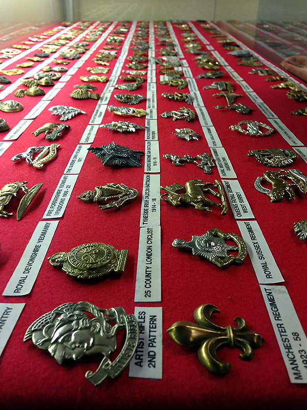 Military badges on display at The Muckleburgh Collection.