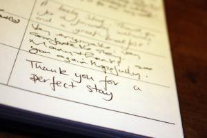 Close up of Ogilvy House Guest Book.